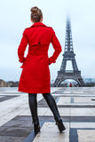 Seen from behind woman looking at Eiffel tower, Paris Royalty Free Stock Photography