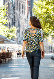Seen from behind woman near Sagrada Familia having walking tour Royalty Free Stock Photography