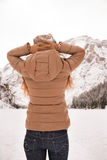 Seen from behind woman outdoors looking on snow-capped mountains Royalty Free Stock Photo