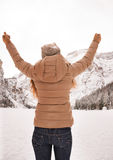 Seen from behind woman among snow-capped mountains rejoicing Royalty Free Stock Photo