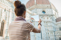 Seen from behind woman tourist sightseeing and taking photo Stock Photos