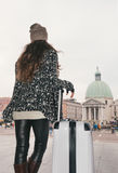 Seen from behind young woman with big luggage bag in Venice Stock Photo