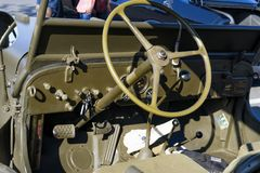 Details of WWII Jeep - Steering Wheel and Dashboard. Seen at Cars & Coffee in Folsom, California. A World War II classic, the Jeep, probably the most venerated Royalty Free Stock Images