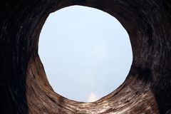 Seen through the cave to the sky. Royalty Free Stock Image