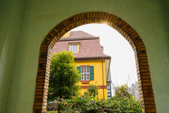Seen exotic buildings in sunny winter afternoon from arched gate Stock Images