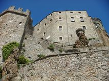 Seen by the lower part of the imposing abbey of St. Michael in Val of Souza in Italy. Royalty Free Stock Image