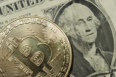 Single Bitcoin showing the surface detail of the coinage. royalty free stock images
