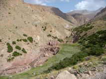 Landscape of the mountains of the Atlas in Maroc with a river with few water. Royalty Free Stock Image