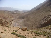 Landscape of the mountains of the Atlas in Maroc with the traces of a river- Royalty Free Stock Photos