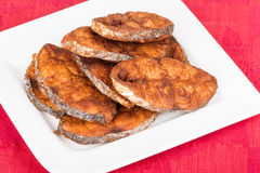 Seer Fish Fillets Fry. Delicious seer/mackerel fish fillets fry. The fish is marinated in cayenne pepper, salt and deep fried Royalty Free Stock Image