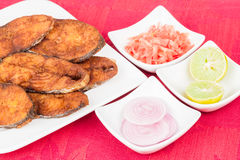Seer Fish Fillets Fry. Delicious seer/mackerel fish fillets fry. The fish is marinated in cayenne pepper, salt and deep fried Stock Photo