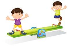 Дети играя с seesaw Стоковые Фото