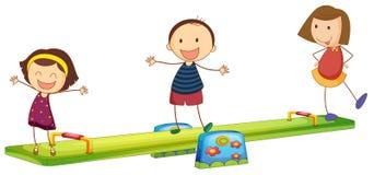 Дети играя с seesaw Стоковая Фотография