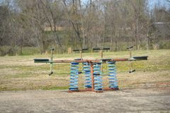 Seeasw on a Playground for Children. A seesaw also known as a teeter-totter or teeterboard is a long, narrow board supported by a single pivot point, most Royalty Free Stock Images