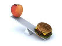 Seesaw with apple and hamburger Royalty Free Stock Images