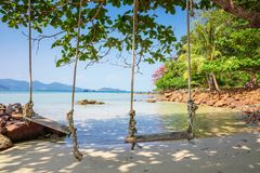 Seesaw on the beach of a tropical. Island Stock Photo