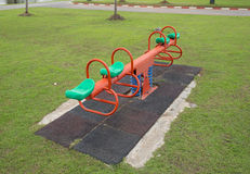 Seesaw on a children playground Stock Photos