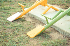 Seesaw. Colorful seesaw in outdoor playground for kids Royalty Free Stock Images