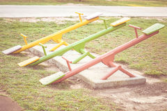 Seesaw. Colorful seesaw in outdoor playground for kids Stock Photos