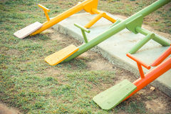 Seesaw. Colorful seesaw in outdoor playground for kids Royalty Free Stock Image