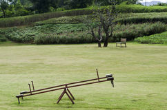 Seesaw in a garden Royalty Free Stock Image