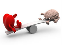 Seesaw with heart and brain Stock Photos