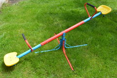 Seesaw for kids. Children swing on the grass Stock Photos