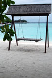 Seesaw on the Maldivian beach. Empty seesaw on the beach, Maldives Stock Photos