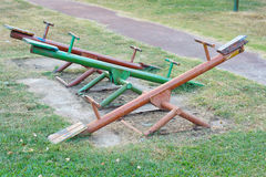 Seesaw. Old seesaw in outdoor playground for kids Royalty Free Stock Image