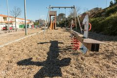 A seesaw and other swings in an empty park in a peripheral area of Caceres, Extremadura, Spain. stock photos