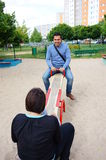 Seesaw people Royalty Free Stock Images