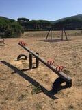 Seesaw on playground, Punta Ala, Tuscany, Italy Royalty Free Stock Photos