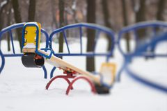 Seesaw playground in snow Stock Images
