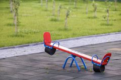 Free Seesaw Swing In Big Yard With Soft Rubber Flooring On Sunny Summer Day Stock Photography - 154403222