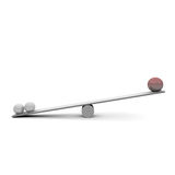 Seesaw. Three balls on a seesaw Stock Images
