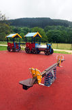 Seesaw and train on playground for children Royalty Free Stock Images