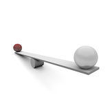 Seesaw. Two balls on a seesaw Stock Photos
