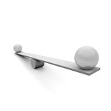 Seesaw. Two balls on a seesaw Royalty Free Stock Images