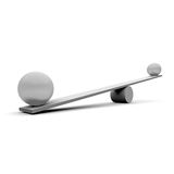 Seesaw. Two balls on a seesaw Stock Photo