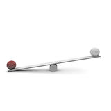 Seesaw. Two balls on a seesaw Stock Photography