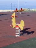 Seesaws на спортивной площадке морем Стоковое Изображение RF