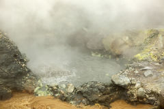 Seething cauldron of boiling water in crater Mutnovsky volcano. Royalty Free Stock Images