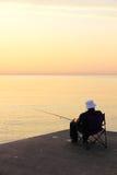 Seeufer-Sonnenuntergang-Fischen Stockbilder