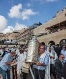 Sefer Torah in case keeps believing Jew. JERUSALEM, ISRAEL - OCTOBER 12, 2014: Morning autumn Sukkot. The area in front of Western Wall of  Temple. Crowd of Stock Images