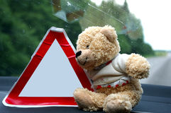 Sefety on the road. Toy with a traffic sign Royalty Free Stock Image