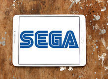 Sega logo. Logo of game developer company sega on samsung tablet on wooden background Stock Images