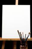 Segeltuch, Pinsel und Gestell Lizenzfreie Stockbilder