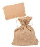 Segeltuchsack mit Pappzeichen Lizenzfreie Stockfotos