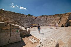 Some tourists visit the ruins of the ancient Greek theater of Se. SEGESTA, ITALY - AUGUST 30, 2017: Some tourists visit the ruins of the ancient Greek theater of royalty free stock photography