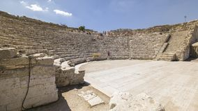 Some tourists visit the ruins of the ancient Greek theater of Se stock photography